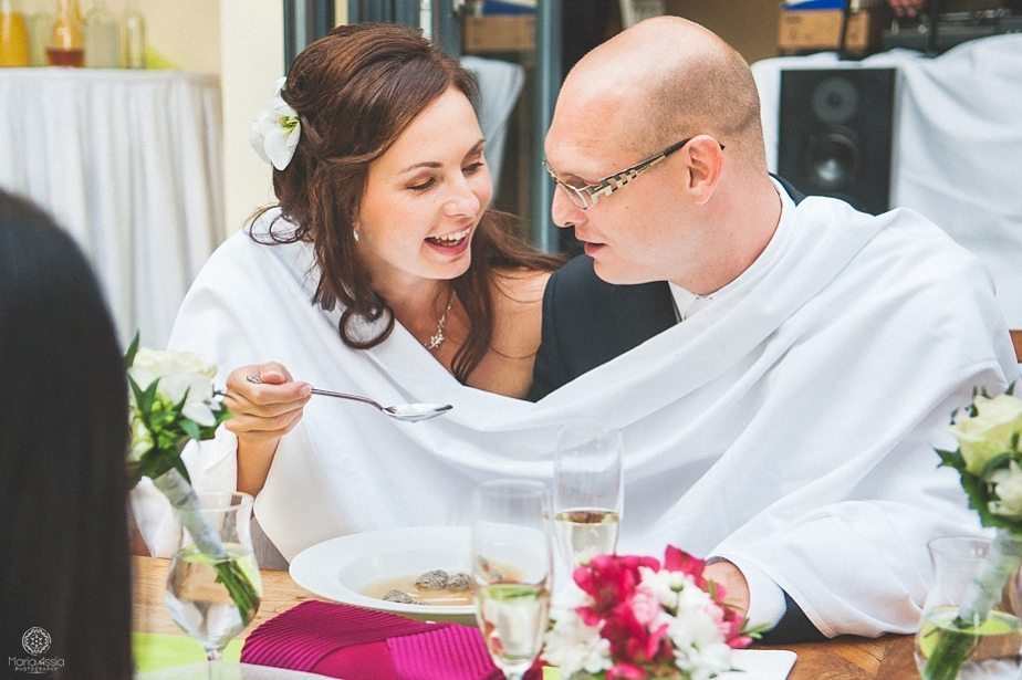 Bride and groom feeding each other at a Prague star summer palace wedding destination wedding.jpg