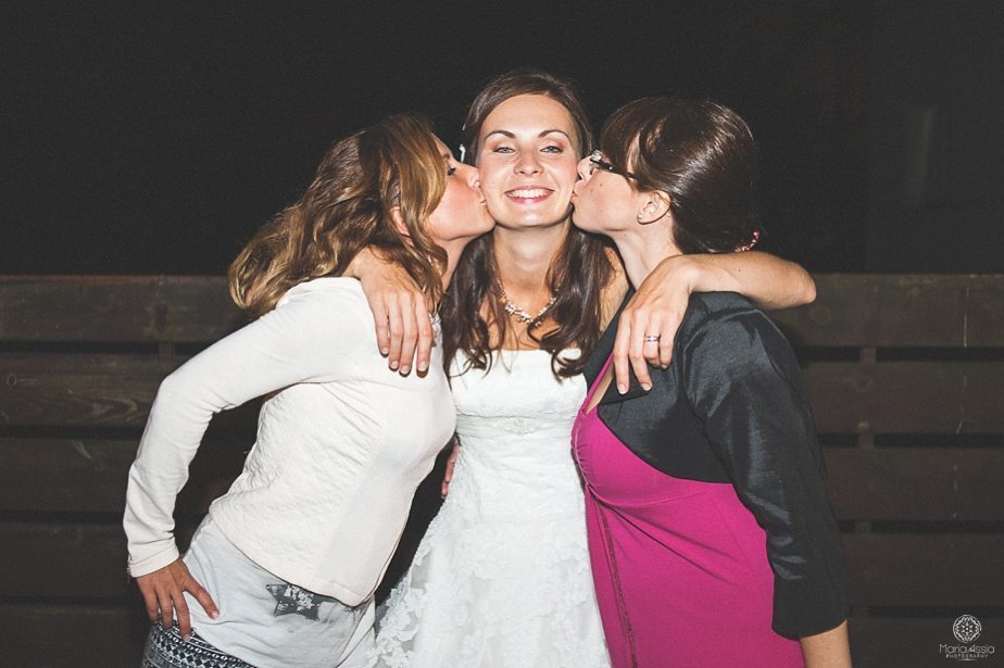 Bride and her best friends kissing.jpg