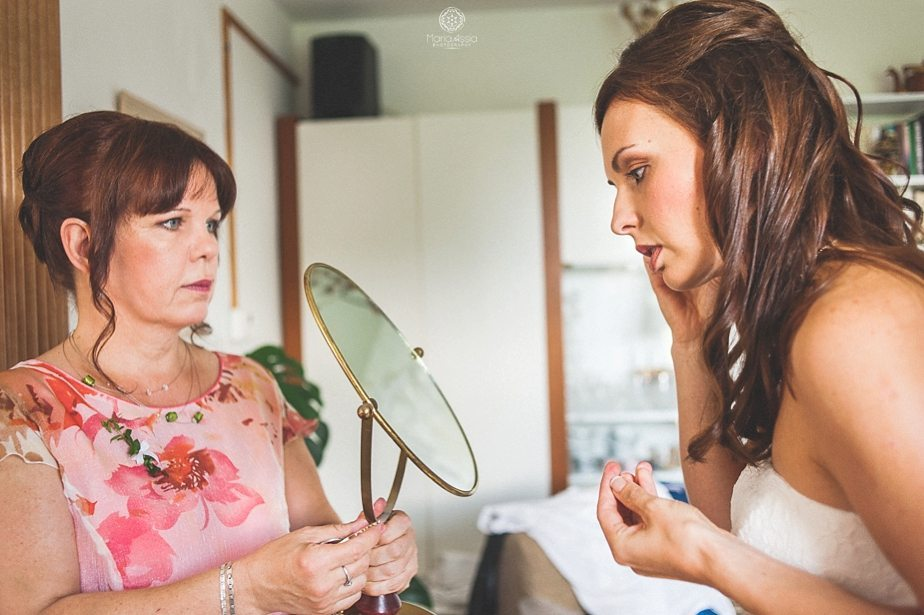 Bride putting in her earrings.jpg