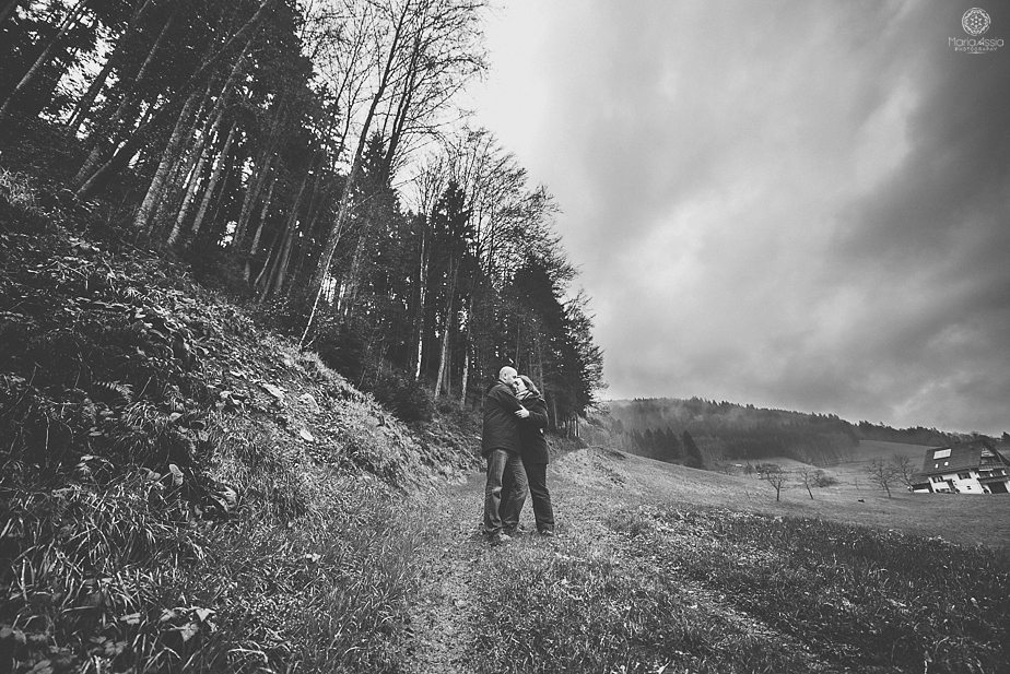 Couple standing on a woodland path in the Black Forest mountains by destination wedding photographer Maria Assia Photography