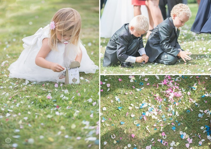 Flower girl and ring bearers picking up the fallen confetti