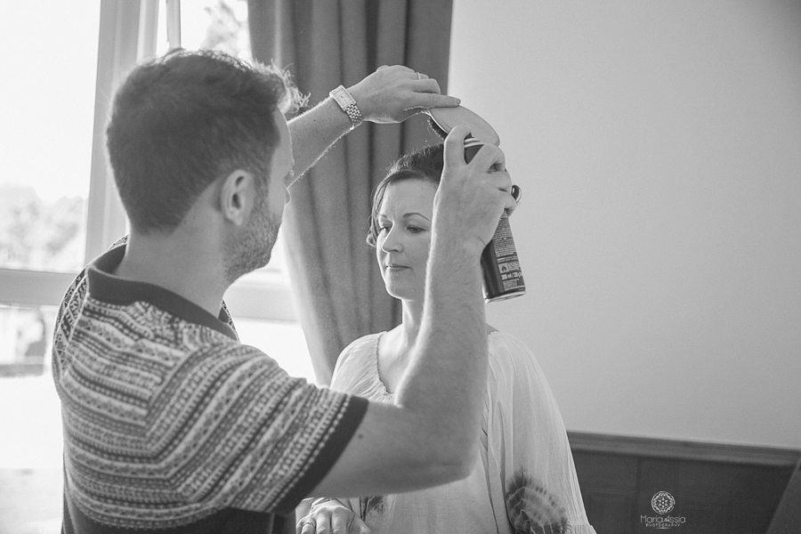 Hair stylist finishing up the bridesmaid's hair