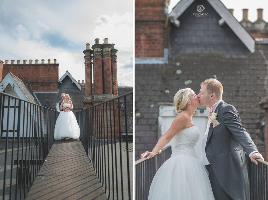 Bride and Groom kissing on the fire escape at the Bickley Manor Hotel