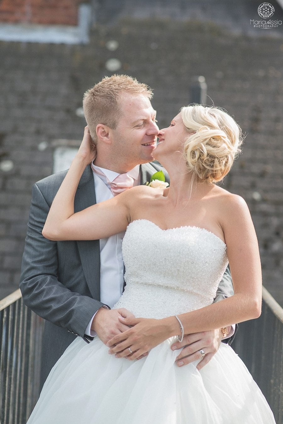 Bride and Groom hugging and smiling at each other at Bickley Manor Hotel
