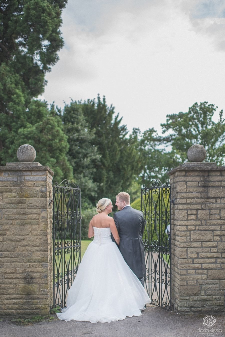 Bride and groom walking through the gate to the grounds at Bickley Manor Hotel in Kent