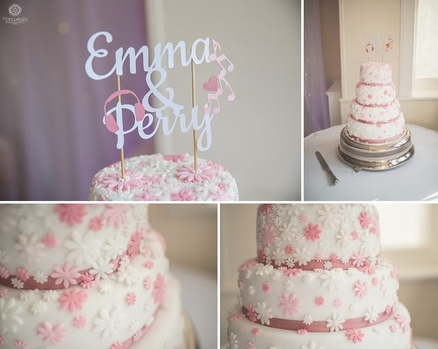 Tiered wedding cake with pink and white icing flowers