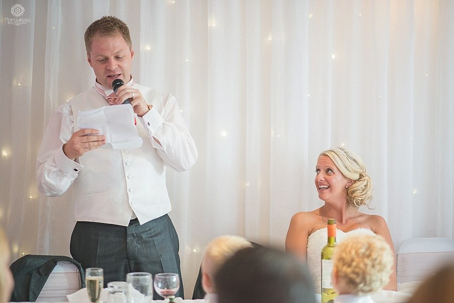 Bride laughing at the groom's speech