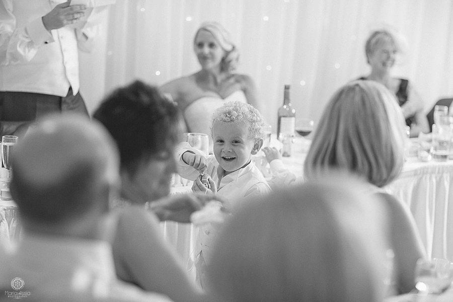 Ring bearer having fun at wedding reception