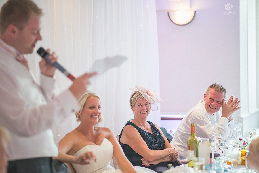 Bride's parents laughing at groom's speech