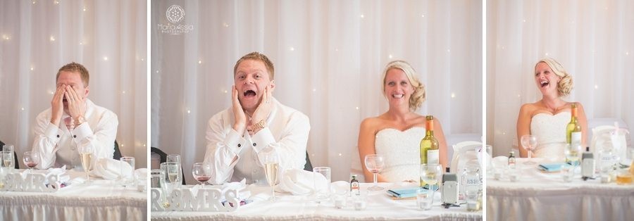 Bride and Groom laughing at best man's speech