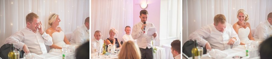 Best man speaking and bride and groom laughing at the best man's speech