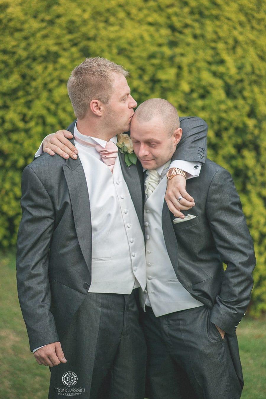 Groom and his best man hugging