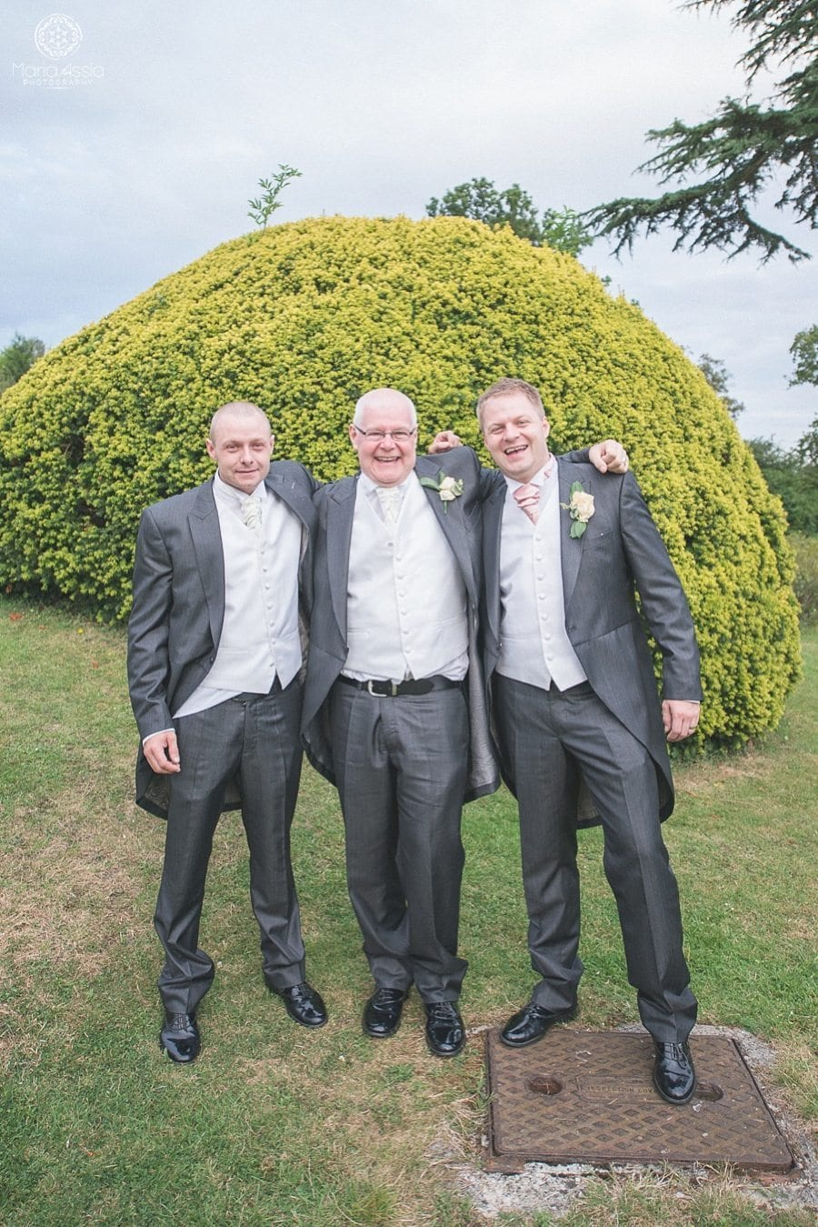 Groom hugging his father and brother