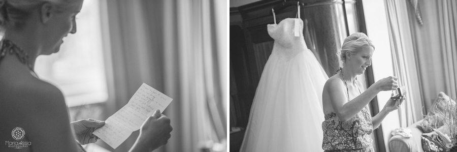 Bride reading her groom's letter and wearing her wedding gift bracelet