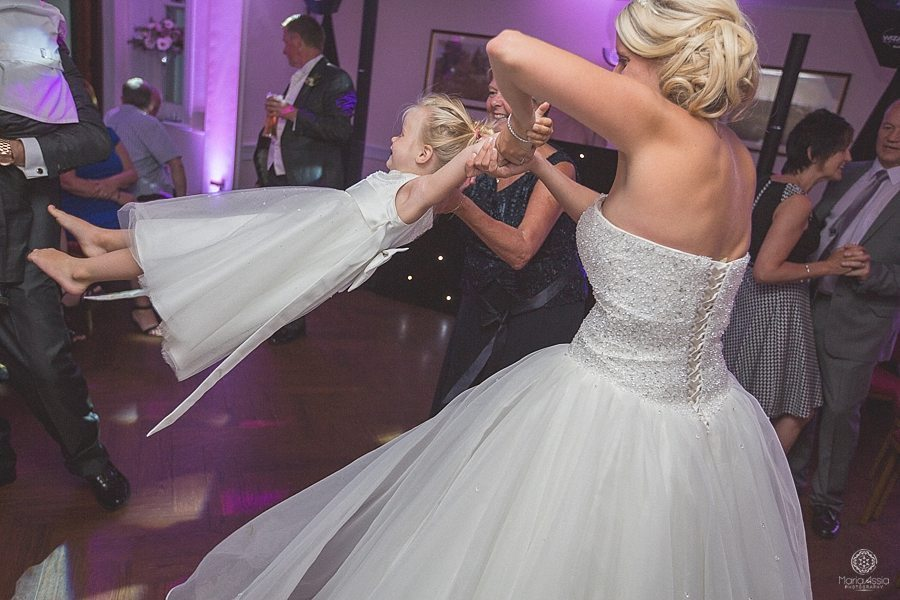Bride lifting her daughter in the air to music