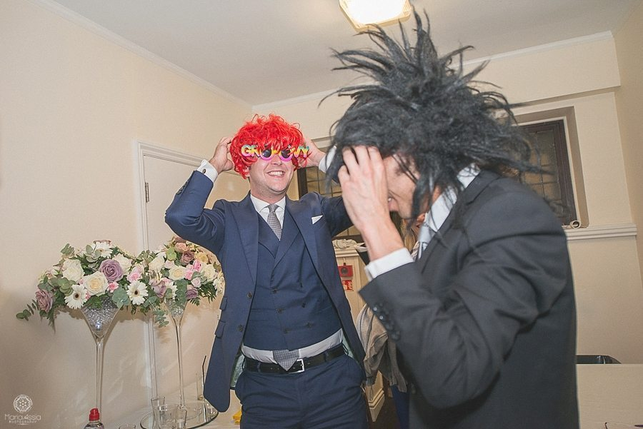 Wedding guests wearing funny wigs