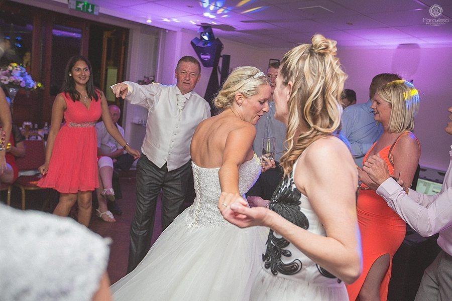 Bride dancing with her wedding guests