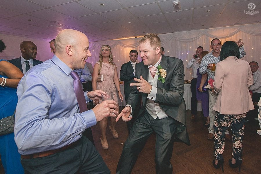 Groom dancing with his wedding guests