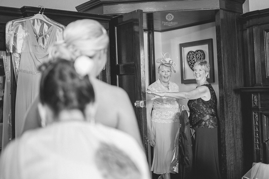 Bride and Groom's mum walking in and seeing the bride all dressed for the first time, wedding photographer in Kent