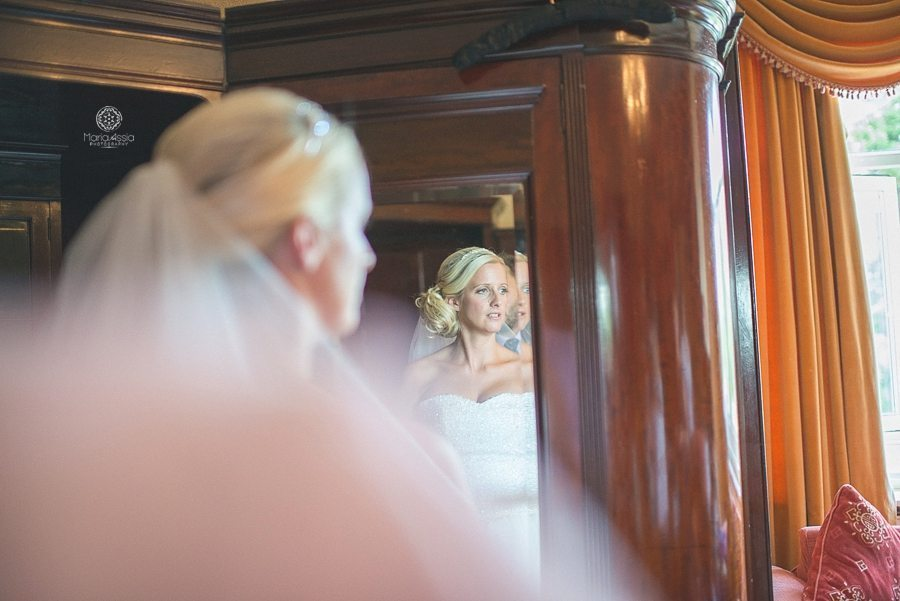 Bride looking out of the window at Bickley Manor Hotel