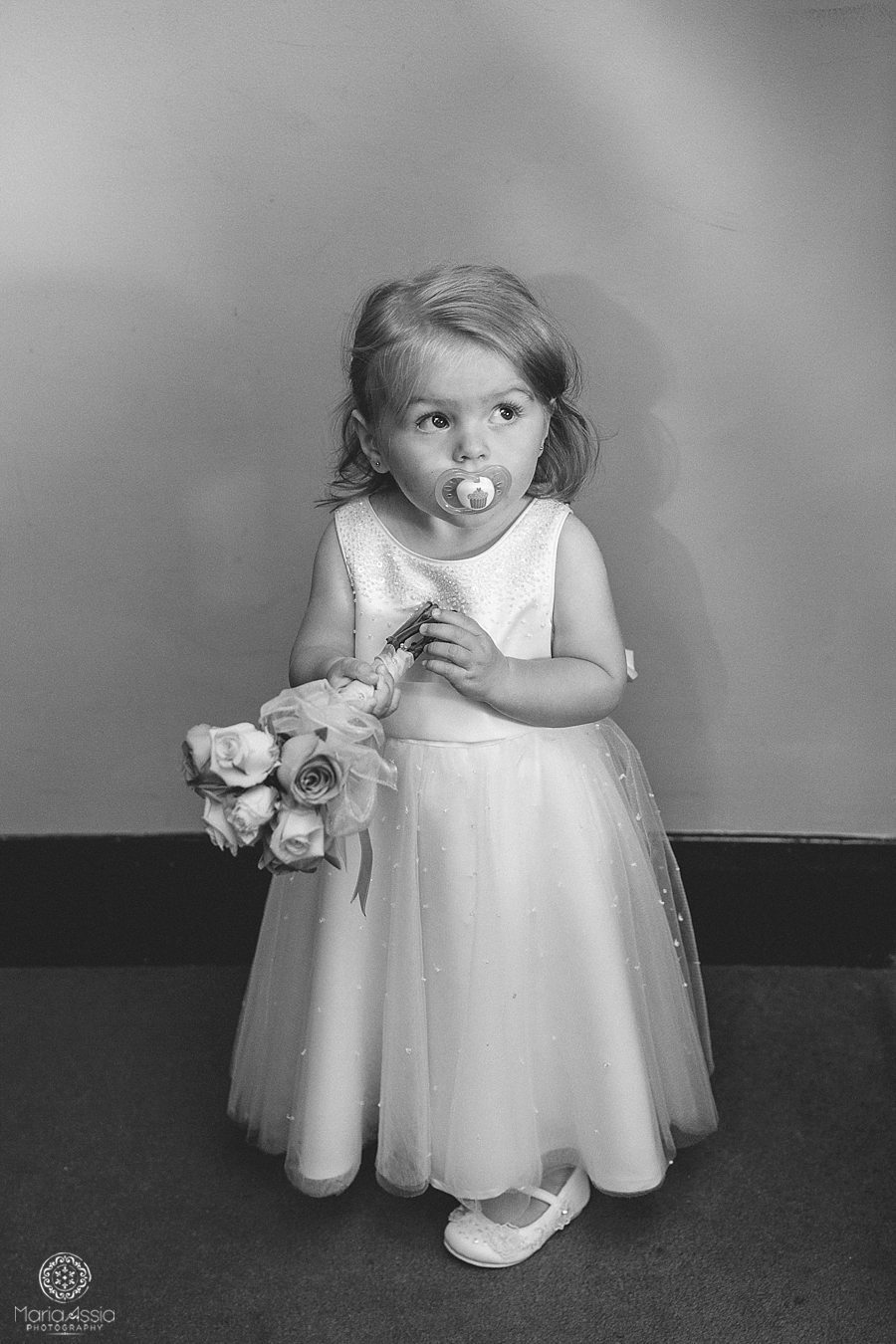 Black and White portrait of a flower girl at the Bickley Manor Hotel by Maria Assia Photography, Wedding photographer in Kent