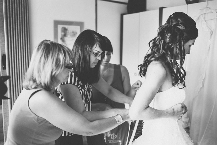 Friends dressing the bride.jpg