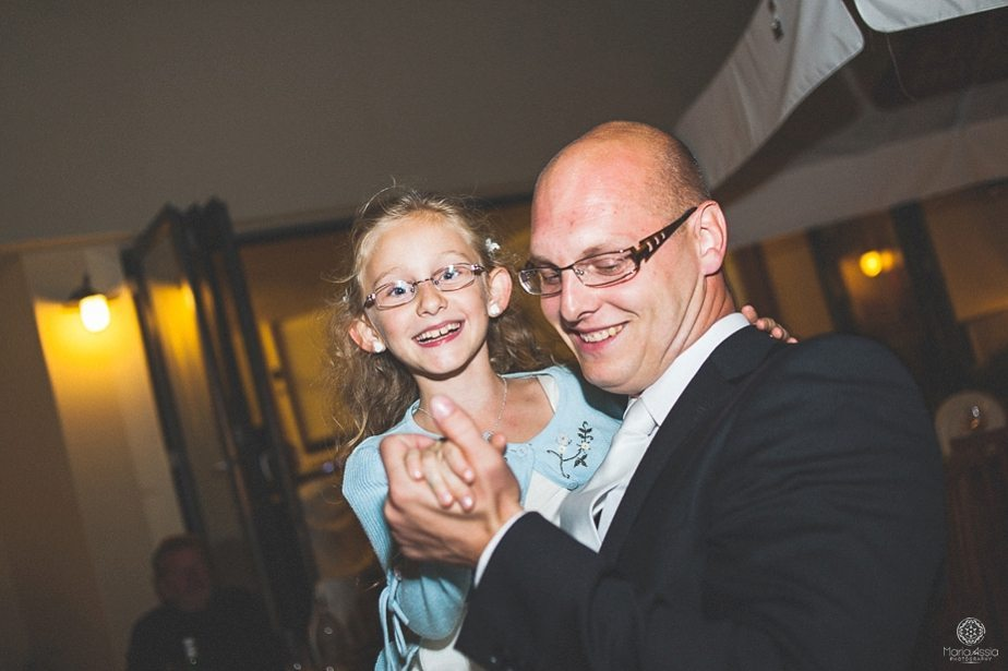 Groom and his niece dancing and laughing.jpg