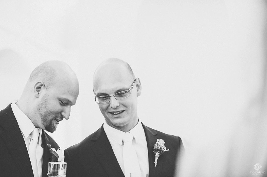 Groom chatting with his best man by destination wedding photographer Maria Assia Photography.jpg