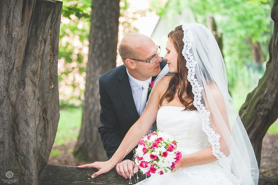 Groom coming close to kissing his bride in the park by destination wedding photographer Maria Assia Photography.jpg