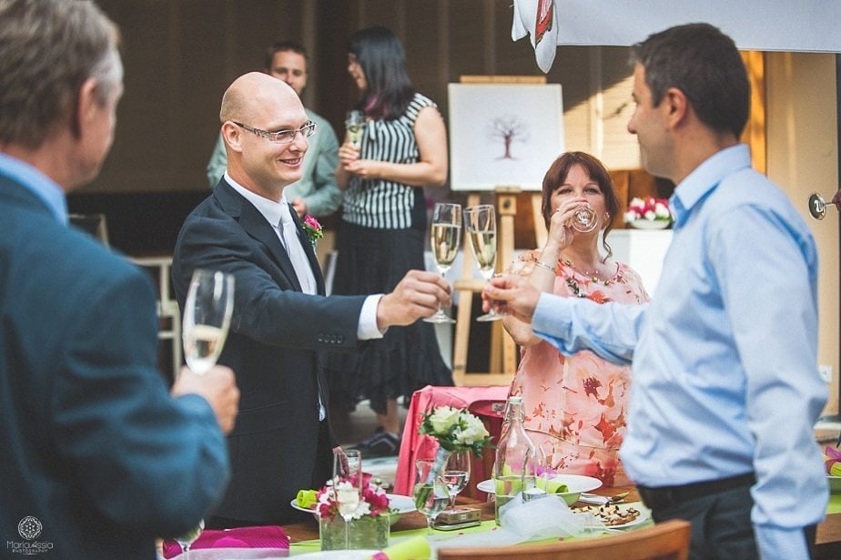 Groom toasting with his best friend and other guests.jpg