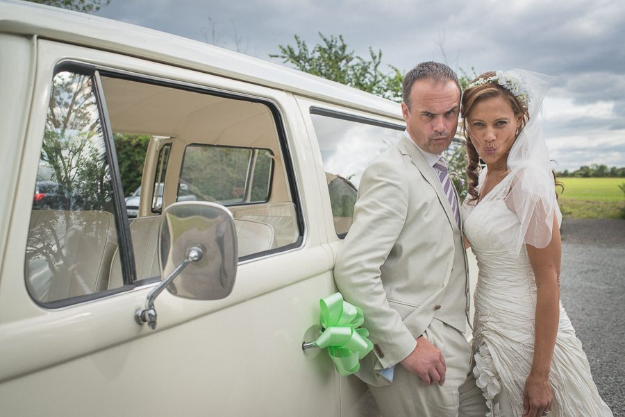 Bride and Groom pull a Zoolander face in front of a VW wedding van