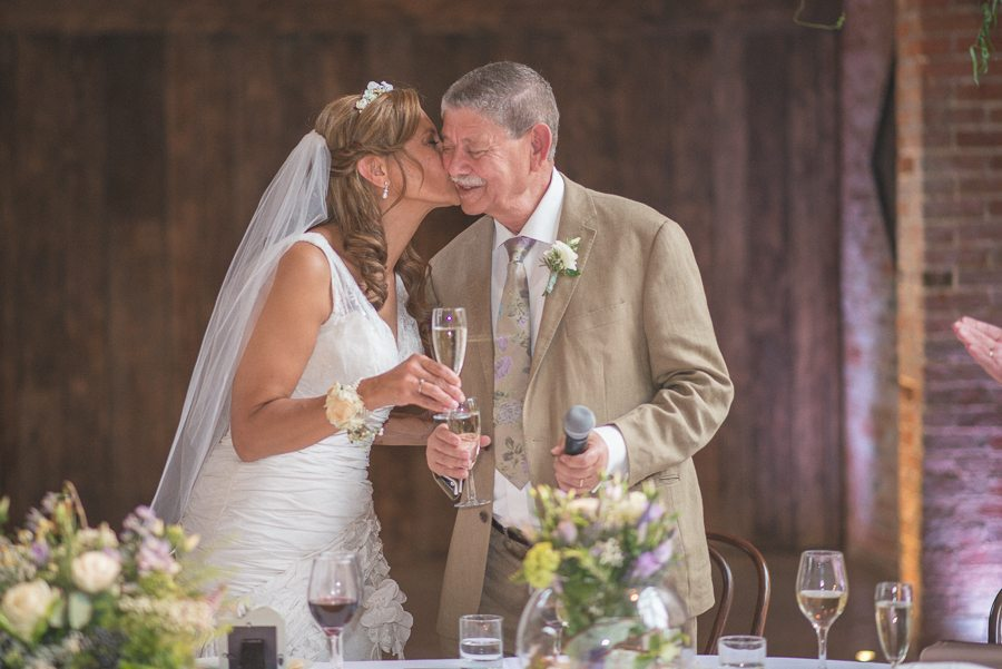 Bride kissing her father on the cheek