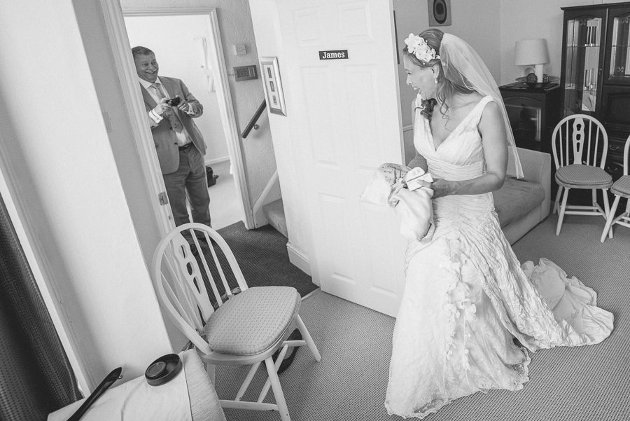 Shustoke Farm Barns wedding bride seeing her dad for the first time