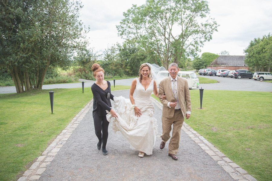 Bride arriving at her Shustoke Farm Barns wedding with her father