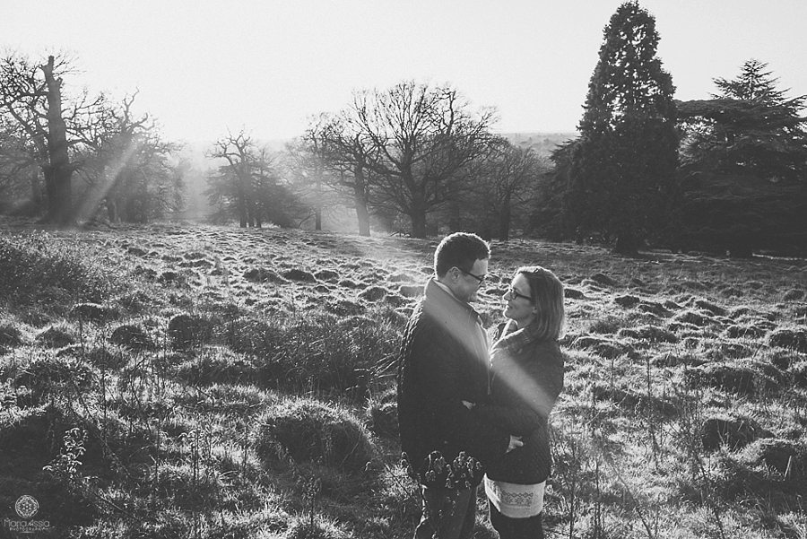Pembroke Lodge winter Pre-wedding photo shoot of man and woman standing in the evening sun