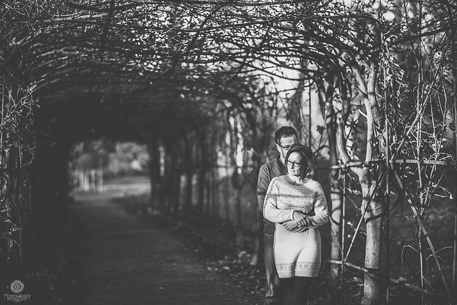 Man hugging woman on their Pembroke Lodge winter pre-wedding photo shoot