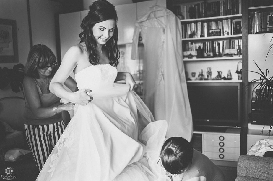 friends tidying a bride's dress.jpg