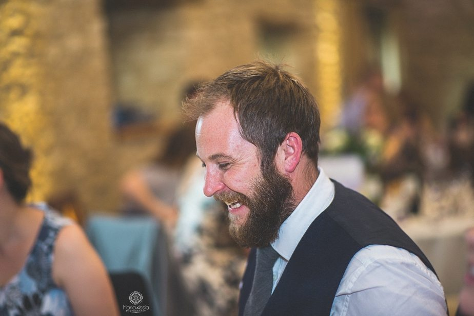 A wedding guest laughing at speeches at Caswell House