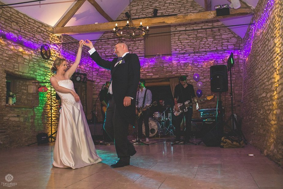 Bride and Groom dancing in front of the band at their Caswell House purple themed autumn wedding