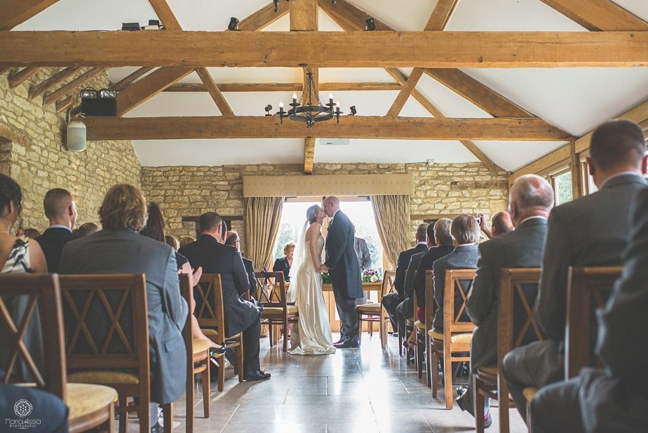 Bride and Groom kissing at their Caswell House Purple themed autumn wedding