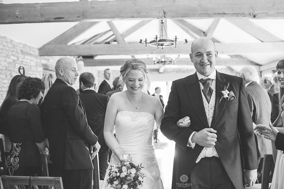 Bride and groom walking down the aisle at Caswell House together