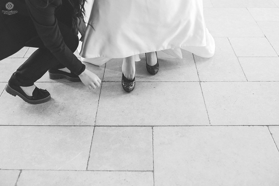 Bride putting on her wedding shoes at Caswell House