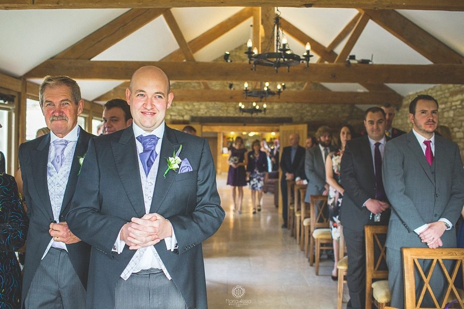 Groom waiting for his bride at the end of the aisle at Caswell House Purple Themed Autumn Wedding