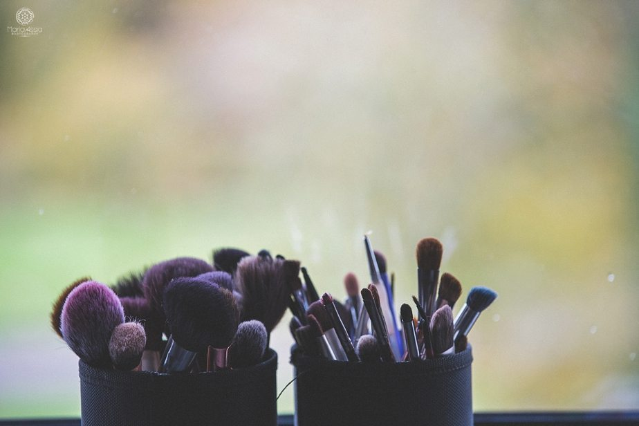 Make up brushes standing in the window