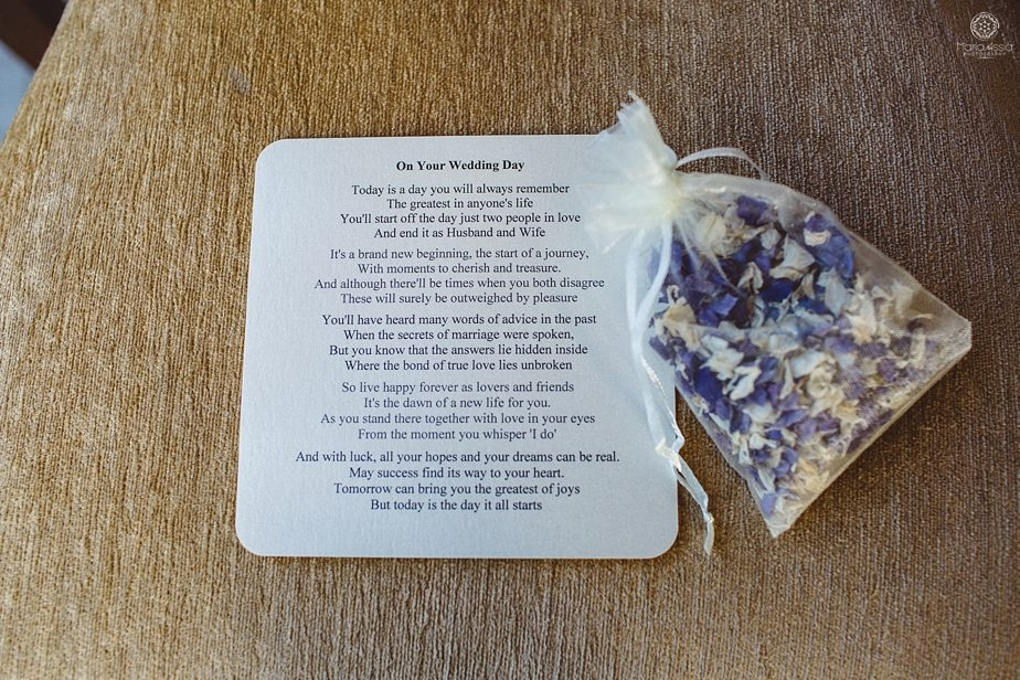 Prepared purple themed autumn wedding reading lying on a chair with rose petal confetti