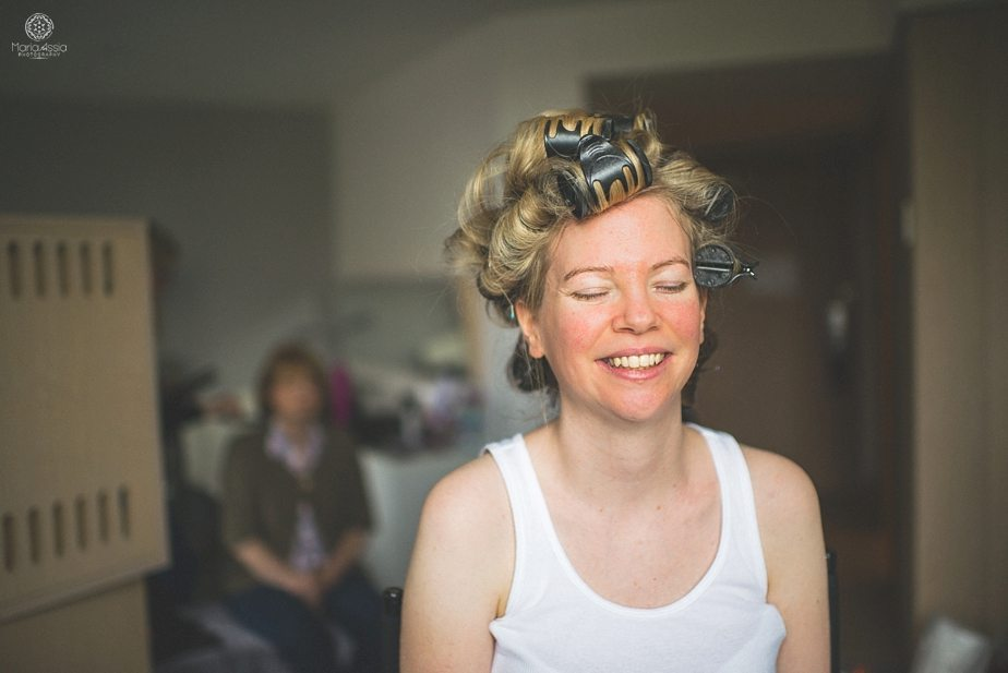 Smiling Bride with rollers in her hair