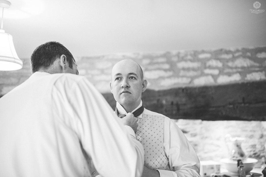 The best man adjusting the groom's tie