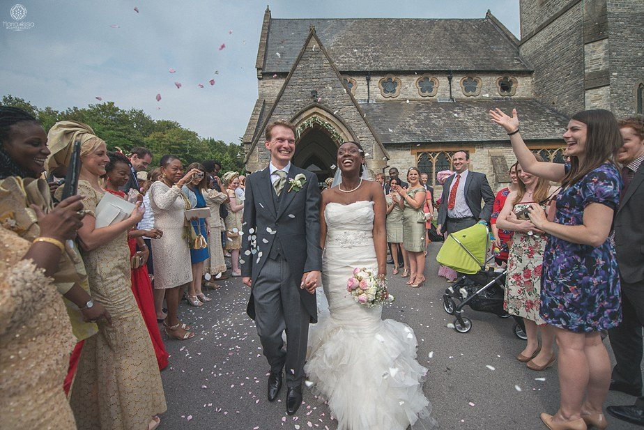 Bride and Groom confetti at Christ Church Colourful Ethnic Wedding in Winchester