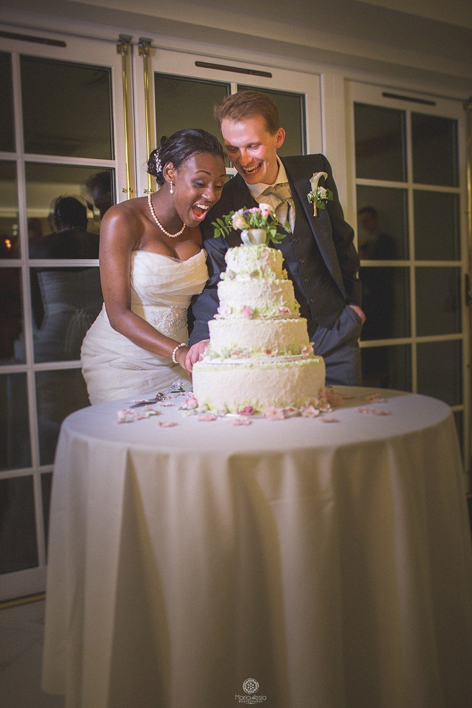 Bride and Groom cutting the cake at Froyle Park Ethnic Colourful wedding