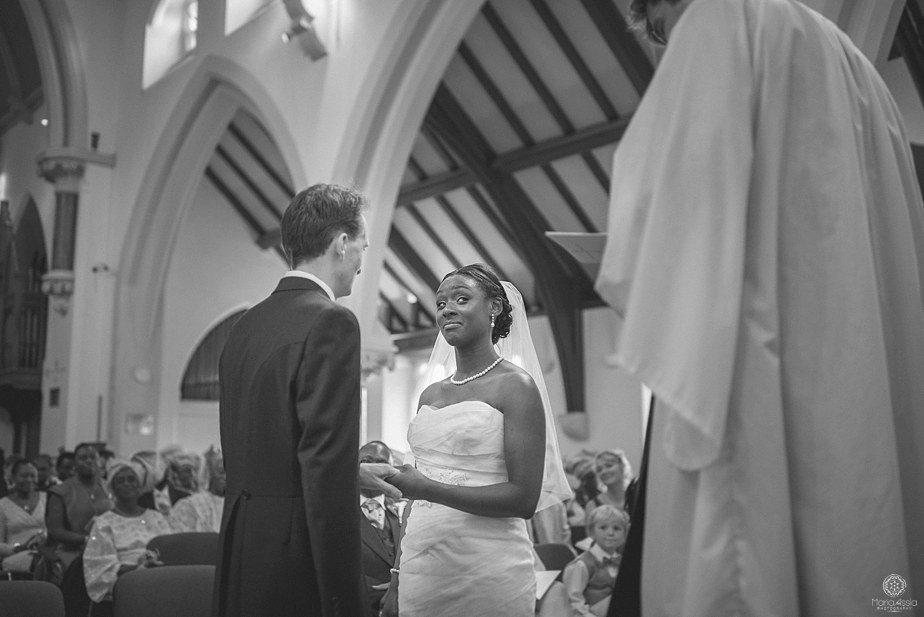 Bride giving a funny look to the vicar during her vows